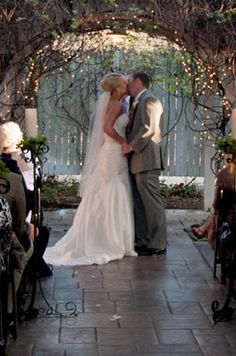 Arch with lights, branches, flowers     Arch will be decorated with moss greenery and flowers to match the centerpieces - may also use curly gravevine branches to decorate it up.