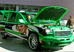 2005 GMC Sierra, Beautiful Models and Enhanced Performance at SEMA Show in Las Vegas - Matt Andrews Airbrushing put on the final touches of the beautiful models on the Lucky Luciano GMC Sierra http://www.knfilters.com/news/news.aspx?ID=2383