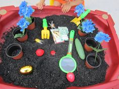 Sensory table idea; great for spring time. Most of the items for this set up were bought at the Dollar Tree! Toddler Sensory Bins, Sensory Games, Sensory Tubs, Sensory Play, Toddler Crafts, Kindergarten Science, Preschool Art, Fine Motor Skills Development, Role Play Areas
