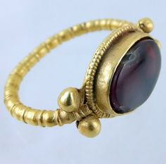 Ancient Roman gold ring with garnet.Ca 400 A.D.
