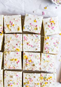 The Best Sugar Cookie Bars | Browned Butter Blondie | These super soft and perfectly buttery sugar cookie bars are the perfect last minute dessert recipe o feed a crowd. Topped with a generous layer of homemade vanilla buttercream and festive sprinkles, these one pan wonders are as easy as they are delicious! #cookiebars #sprinkles #dessert Buttery Sugar Cookies, Sugar Cookie Dough, Dessert Bars, Dessert Recipes, Bar Recipes, Kitchen Recipes, Easy Desserts, Cookie Recipes, Food Photography Props