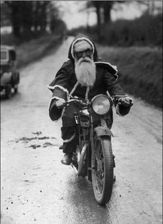 Reindeer's are in for their annual service. santa | motorbike | black & white | santa suit | christmas | vintage | road bike | bike | christmas | holiday season | presents | santa sleigh | Saint Nicholas