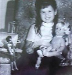 little Marie Osmond with her dolls