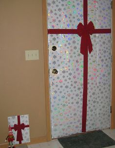 Elf wraps the front door and creates one for himself, too #elf on the shelf