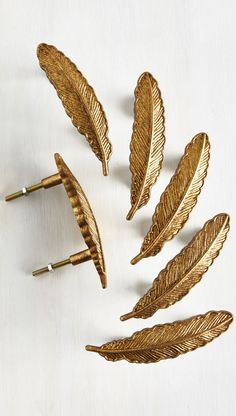 Sleight as a Feather Drawer Pulls. Flaunt your boho-inspired flare by bedecking your dresser with these gold-painted pewter drawer pulls!