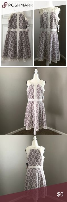 R & K ORIGINALS Floral Lace Dress Size 12 Floral lace dress  with violet/magenta lining, Fitted waist and circle skirt. Beautiful detailing and washable. New with tags.   👗NWT 👠TTS  ✨Smoke Free/Pet Free Home  💄NO Trades   Reasonable offers are welcome! Notify me with any questions. Feel free to bundle! Thanks for shopping my closet! R & K Originals Dresses Midi
