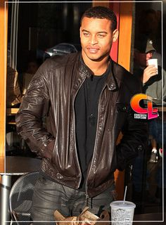 Robert Ri'chard...keeping it simple in leather motorcycle cut jacket, jeans and black tee.