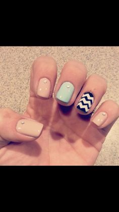 Nude nails with accent turquoise nail and chevron.