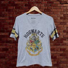 "Just a nicely broken in Harry Potter Hogwarts tee! Vneck shirt has a nice vintage look with normal fading/pilling from washing. No holes or stains. Shirt says fits an XL but I think it runs a lil smaller & fits like a large. Just check your measurements before buying. Any questions just askFREE shipping in US! Size- XL Pit to pit- 17.5"" Length-25.5"" Sleeves from shoulder- 10"" #harrypotter #hogwarts #movie #depopusa #grey #gray #thrifted #thrift #stripes #tshi..."
