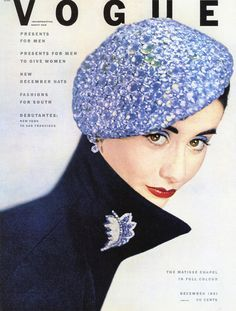 Vogue - December 1951 - Hat by Lilly Dachè -  Jacket by Charles James - Diamond and sapphire clip by Van Cleef  Arpels - Cosmetics by Giourielli - Photo by Erwin Blumenfeld