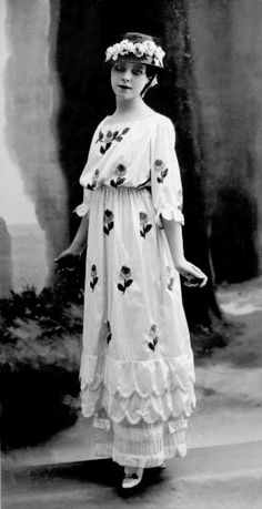 A model is wearing a charmingly pretty high-waisted, skirted dress from Jeanne Lanvin. #Edwardian #vintage #fashion #1910s