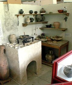 A kitchen set up probably in some museum inspired from Roman Britain kitchen spaces of that time.
