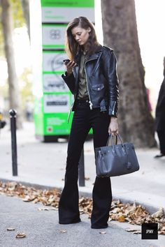 Black leather jacket + khaki shirt + black flared jeans