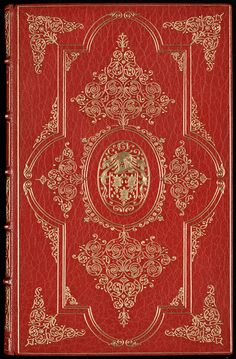 """Binding by Zaehnsdorf, 1914  The upper and lower covers of this red goatskin binding are tooled in gold with a single outer fillet (line), and an inner ribbon panel design decorated with pointillé tools (lines and curves made up with small dots). In the centre is one of the nine armorial variants of Alexander H. Turnbull. The turn-in of the upper cover is stamped in gilt """"Bound by Zaehnsdorf 1914""""."""