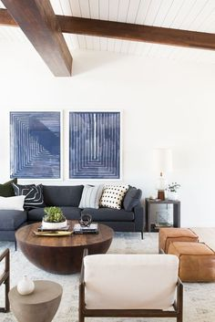 An Eclectic Take on Mid-Century Modern living room | Mid Century modern homes | homes | modern art | modern | modern architecture | #architecture https://www.statements2000.com/
