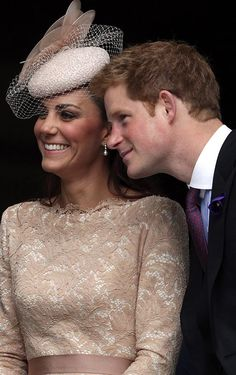 Smile ... Harry leans in as picture is taken of him and Kate