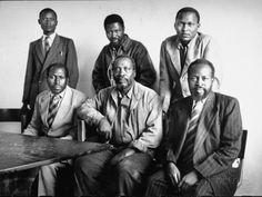 """The """"Kapenguria Six"""". Jomo Kenyatta posing with five of his staff members accused of being Mau Mau leaders in October 1952."""