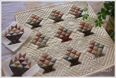 Tiny basket quilt by Sakae Yoshihara  I made one of flower baskets in blues with a very similar layout and quilting...