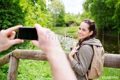 """Laden Sie das lizenzfreie Foto """"couple with backpacks taking picture by smartphone"""" von Syda Productions zum günstigen Preis auf Fotolia.com herunter. Stöbern Sie in unserer Bilddatenbank und finden Sie schnell das perfekte Stockfoto für Ihr Marketing-Projekt!"""
