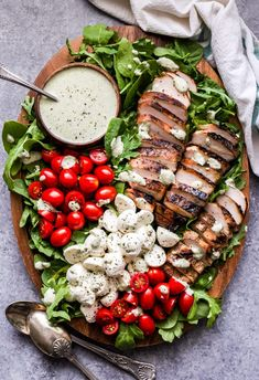 Caprese Grilled Chicken Salad on wood platter with dressing in a bowl Grilled Chicken Salad, Chicken Salad Recipes, Balsamic Chicken, Caprese Chicken, Marinated Chicken, Healthy Recipes, Cooking Recipes, Charcuterie Recipes, Charcuterie Board