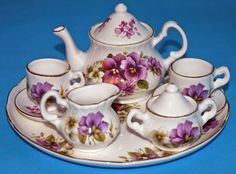 Crown Windsor: Fine Bone China miniature teaset painted with Purple Pansies.Made in Staffordshire. Crown Windsor: Fine Bone China miniature teaset painted with Purple Pansies.Made in Staffordshire. Traditional Teapots, Tea Cup Saucer, Tea Cups, Childrens Tea Sets, Glass Teapot, Tea Pot Set, Coffee Set, Antique China, Tea Sets