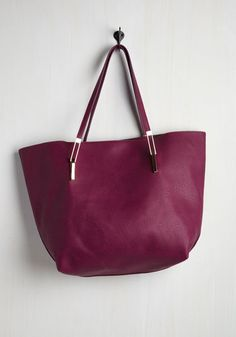 The polls are in and this fabulous faux-leather bag is the obvious winner. Touting reliable functionality in its zippered pockets and spacious interior, as well as dependable style in its versatile plum hue and unique gold hardware, this vegan-friendly tote totally earns your trust!