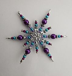 vánoční hvězdička Vánoční hvězdička z korálků a perliček na pevné drátěné konstrukci , velikost 10 cm v barvách stříbrná fialová tyrkysová