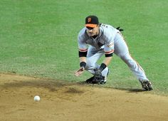 Ryan Theriot #5 of the San Francisco Giants makes a play on a ground ball against the Arizona Diamondbacks at Chase Field on September 16, 2012
