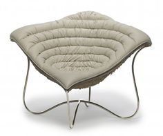 Solara chair in leather with abaca shell and stainless-steel legs by Oggetti.