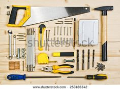 Top View of Assorted Woodwork and Carpentry or Construction Tools on Pine Wood Texture Background. - stock photo