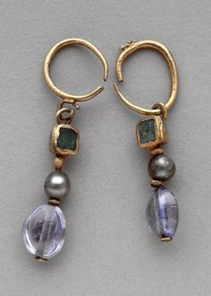 Emerald, pearl, and sapphire earrings, made in the 4th century and found at the Hill of St Louis in Carthage (via).