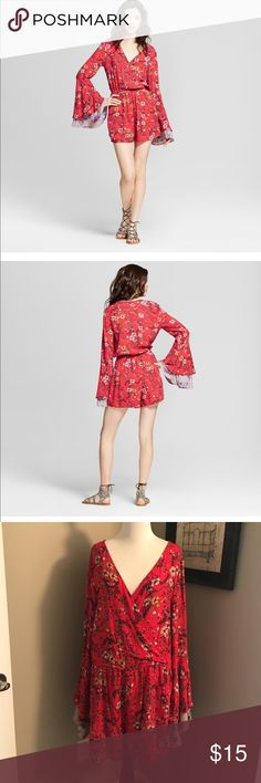 Xhileration Boho Long Sleeve Romper NWT Xhileration. Long sleeves with layered bell cuffs. Beautiful boho floral fabric. V-neck. Pockets. NWT. 100% rayon. Pair with tights and booties. Xhilaration Pants Jumpsuits & Rompers