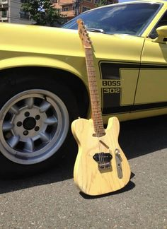 ROAD WARRIOR model Blond natural wood look electric guitar by RS Guitar Works in front of vintage yellow Boss 302 car. RESEARCH #DdO) -  https://www.pinterest.com/DianaDeeOsborne/instruments-for-joy/ - INSTRUMENTS FOR JOY. Called Old Friend SLAB WORKHORSE by RS website: Set of 70's Schaller tuners, a real '82 non fine tuner Floyd, & a set of mid 70's Dimarzio PAFs, arm & back contours, and killer, broke-in feeling neck. btw #humor: RS stands for #REBEL #GUITARS. Photo pinned via Wilson…