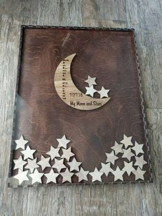 Guest book idea. Guest write name on star and drop it in. Moon with have a large C and the date.