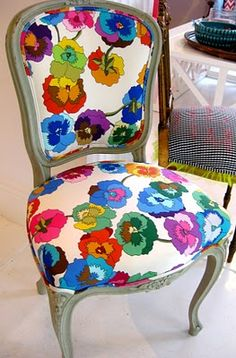 Speaking of chairs!    I love when old chairs are redone with modern, funky, bright fabric!  Who would not be happy when sitting here?     Yes! This is just perfect!!!