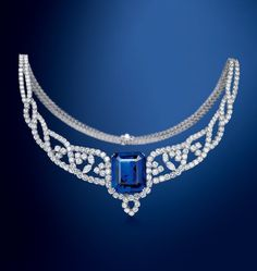 A MAGNIFICENT 91.95 CARAT BURMESE 'ROYAL BLUE' SAPPHIRE AND DIAMOND NECKLACE, BY BOUCHERON. The front set with a cut-cornered rectangular-cut sapphire weighing 91.95 carats, to a series of brilliant and marquise-cut diamond foliate motif swags and brilliant-cut diamond backchain, mounted in platinum.