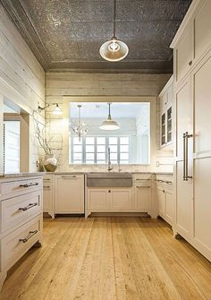 Shiplap, tin ceiling and hidden appliances. Perfect. | tch. https://www.facebook.com/countrylifestyle/photos/a.127000567523.12 7393.6817732523/10154074808532524/?type=1