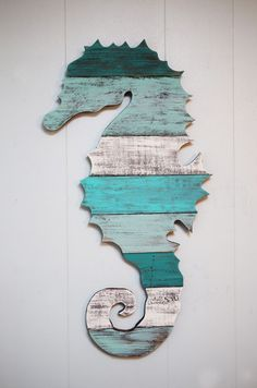 This is a seahorse made out of reclaimed pallet wood. You can have it as plain pallet wood, or hand painted by us to the colors of your