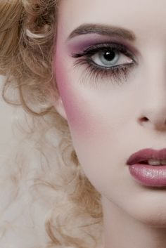 pink and purple vintage makeup with long lower lashes