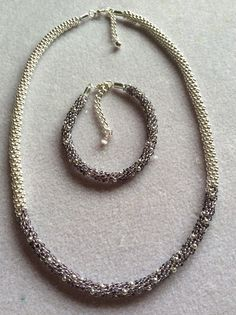 Sterling silver combined with purple beads. Created using Nymo cord rather than S-Lon as the beads are so small