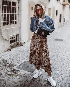 70c2b6a727 Denim jacket over trendy leopard print maxi skirt with white tee and  sneakers. Midi Skirt