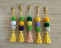 Tassel keychain Tassel bag charm Pom pom key chain Turquoise tassel bag charms Bag accessories Boho accessories Handbag charm Tassel clip  Colorful bag charm / keychain made of hand crafted tassels in shades of blue.  One size.  Length: approx. 8.6 inches / 22 cm  ♥ Heartmade item ♥  All my products come in a nicely crafted wrapping, so they are ready to be given as gifts.  Every piece of jewelry is made in a smoke and pet free environment.  Orders will be mailed by registered and i...
