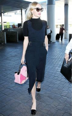 Kate Bosworth wears a black turtleneck with her buckled dress, pairing it with black ballet flats and a pink Loewe puzzle bag.