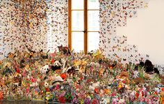 Assembled from hundreds of cutout plants and animals from repurposed textbooks, artist Andrea Mastrovito created a striking installation where a colony of bats clings to the ceiling, a flight butterflies swarm the gallery walls, and all matter of insects, mamammals and plants intermingle across the floor. The sprawling artwork spans the realms of collage, diorama and trompe-l'œil and was inspired in part by H. G. Wells' science fiction novel The Island of Doctor Moreau.