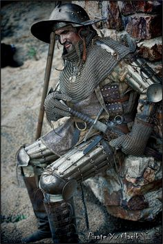 Man at arms,1400-1450, David Bobrink medieval weapons and armor, single handed sword, poleaxe hammer, gambeson, surcoat, brigandine, bishop's mantel, splint upper arms, splint bracers, splint upper legs, chainmail gloves, and visored kettle hat.