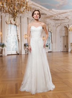 Lillian West lillian west style 6349 Alencon and venice lace fit and flare dress accented by a sweetheart neckline.