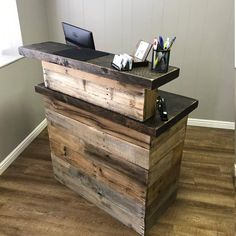 Reclaimed Wood Sales Counter made from reclaimed wood from pallets and roughsawn timbers. This beautiful piece of office furniture is custom made to function as a retail sales counter. Each pallet slat has its own unique patina which creates an amazing piece that is both functional and decorative. Barber Shop Interior, Barber Shop Decor, Beauty Salon Interior, Salon Interior Design, Boutique Interior, Schönheitssalon Design, Design Ideas, Salon Furniture, Office Furniture