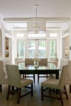 Square table with a mix of benches & chairs - possible for the breakfast room. Julie Nightingale Design