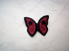 Beautiful black felt and crimson butterfly brooch with hand embroidery, lace flowers and tiny matching beads, the brooch is fastened with a silver colour safety clasp, and would look lovely pinned to and evening dress. Free gift wrapping service on req. Fabric Butterfly, Gift Wrapping Services, Black Felt, Lace Flowers, Silver Color, Hand Embroidery, Brooch, Beads, Gifts