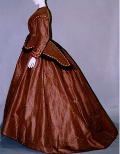 Day dress, 1865. Tobacco-brown silk taffeta brocade bodice and skirt; worn over crinoline; braid and lace on bodice. Kyoto Costume Institute